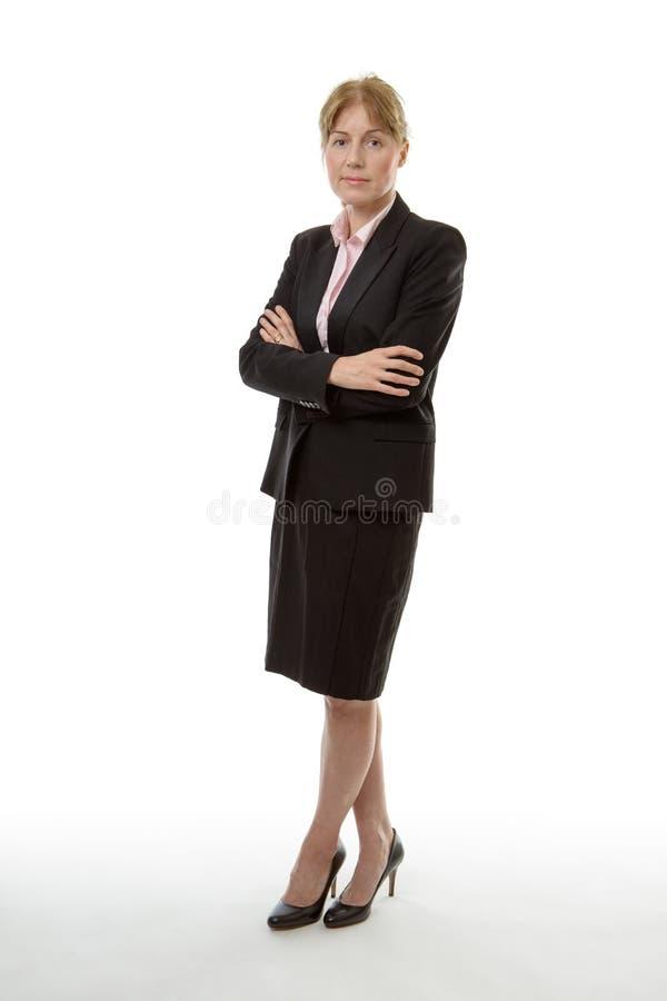 Levantarse a la mujer de negocios fotografía de archivo libre de regalías