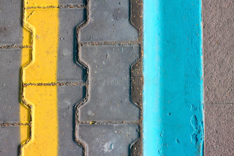 Level asphalted road with a dividing yellow stripes. The texture of the tarmac, top view.. stock image