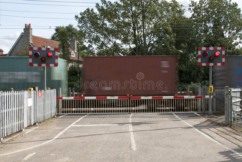 Download Level Crossing Lights And Barrier With Container Train Stock Image - Image of european, kingdom: 35490363