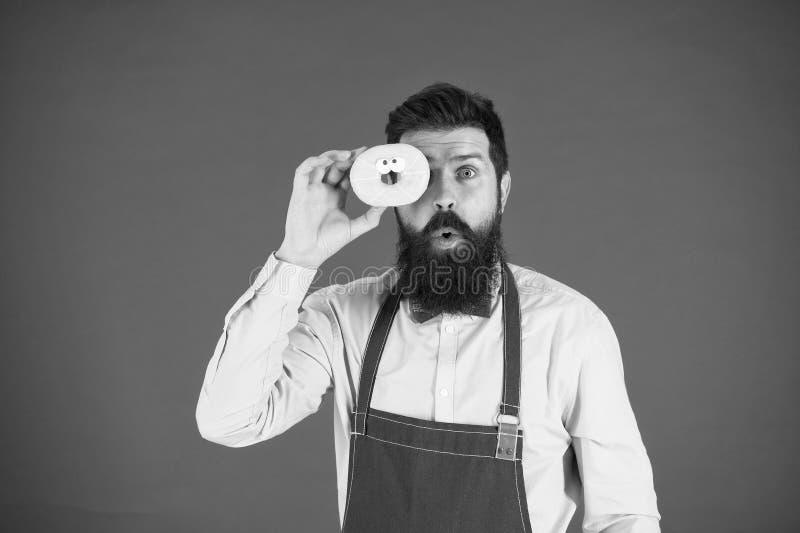 Leven Gedekte man in het pron Dieet en gezond voedsel Doughnut-dieet calorie Voel honger Geen dieet Chef man in café royalty-vrije stock fotografie