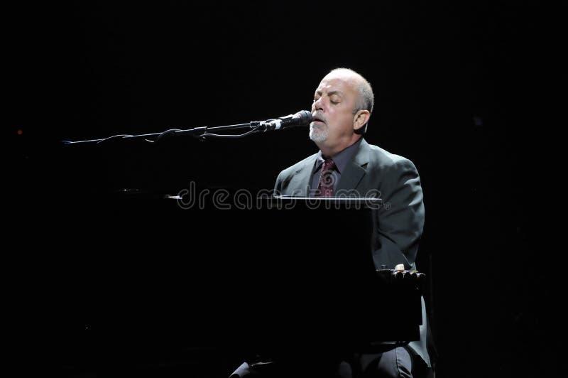 Levend presteren van Billy Joel. stock fotografie