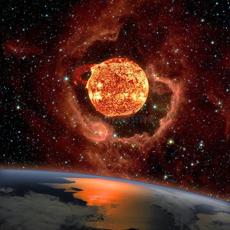 Lever de soleil au-dessus de la terre de planète dans l'espace photos libres de droits