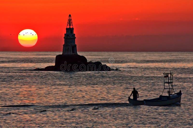 Lever de soleil au phare d'Ahtopol image libre de droits