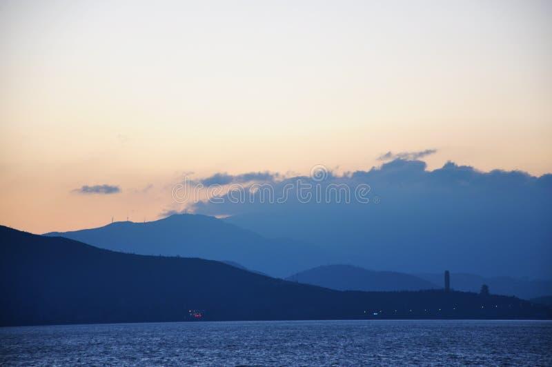 Lever de soleil naturel de paysage dans Erhai CHINE image libre de droits