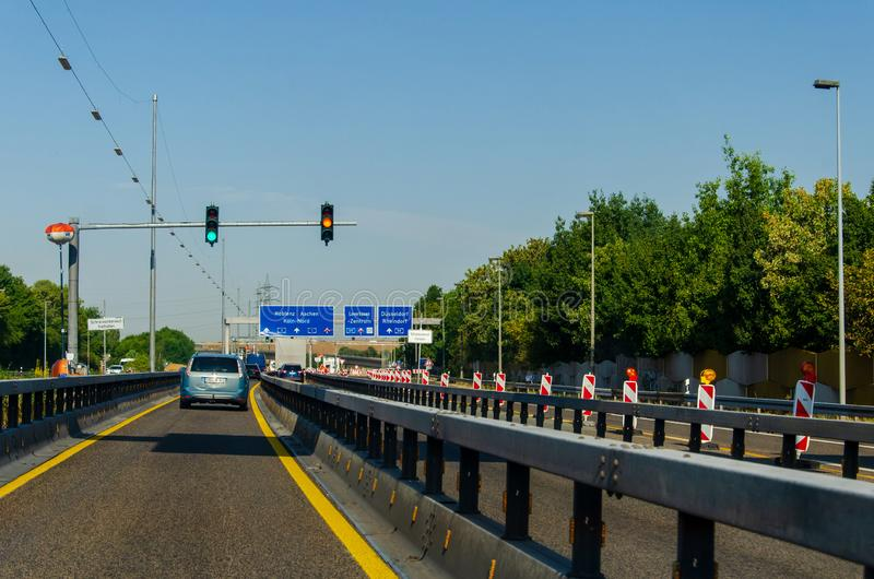 Leverkusen, Germany - July 26, 2019: Road traffic on the German Highway autobahn A1 with road signs and traffic light. Cars ride. On the German autobahn stock photo