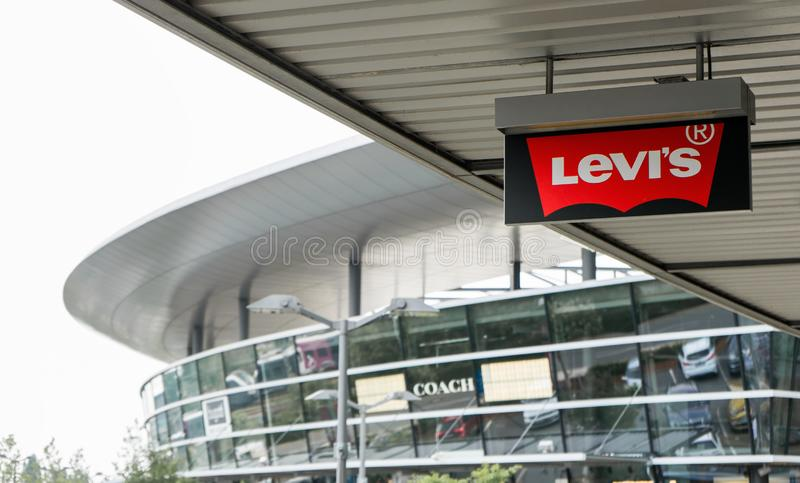 The Levis logo on the ceiling in front of a store in an outlet in Wolfsburg, Germany, June 15, 2018.  stock photos