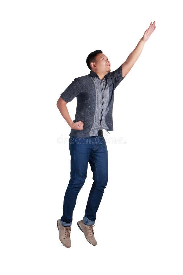 levitación El volar de levantamiento del hombre joven para arriba imágenes de archivo libres de regalías