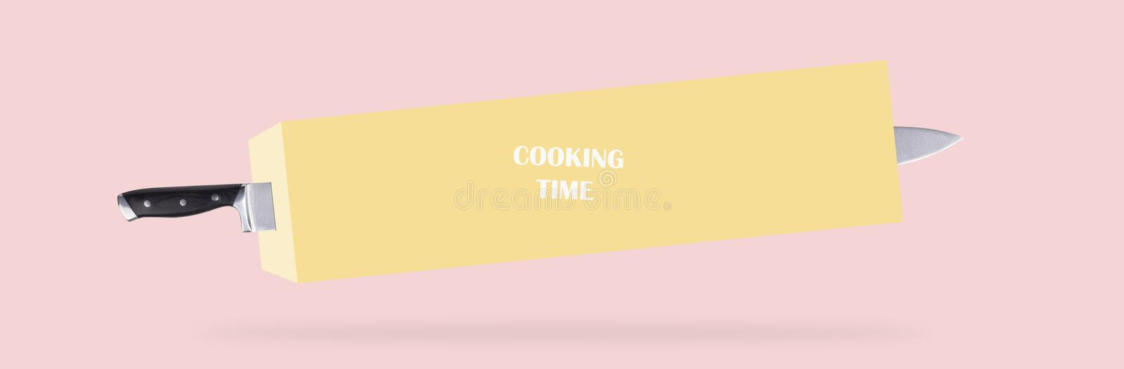 Knife and cooking time. Levitating knife stucked  in stylized butter, over pink background, cooking time concept, panoramic image royalty free stock image