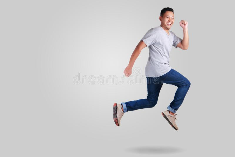 Levitation. Young Asian man jumping dancing walking royalty free stock photos