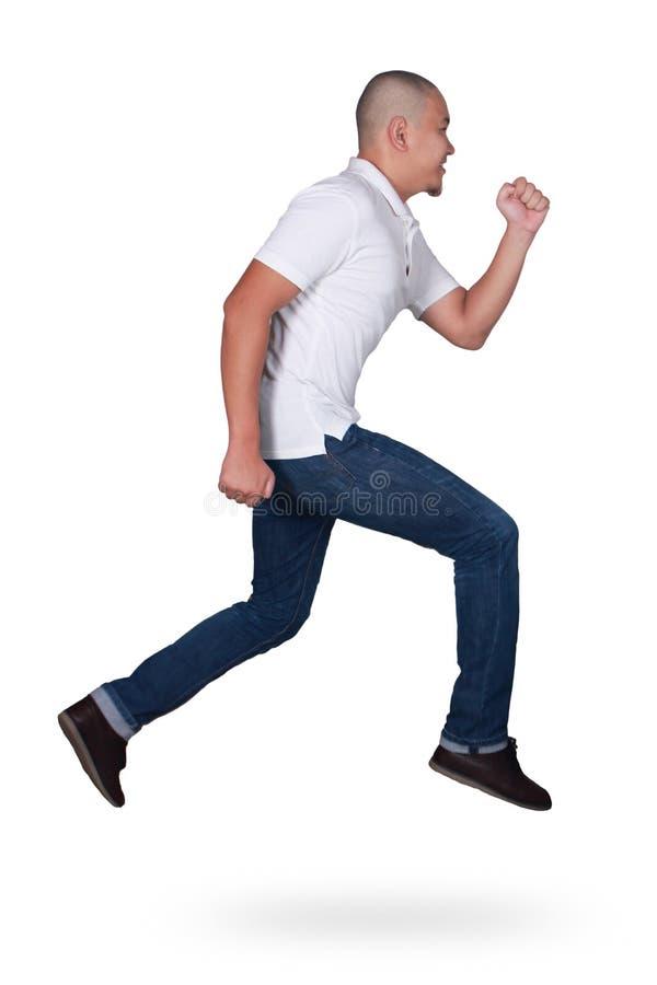 levitation Homem asiático novo atrativo engraçado que salta no passeio da dança do ar imagem de stock