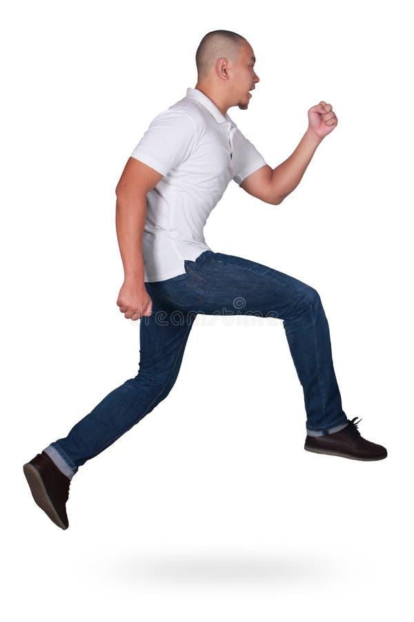 levitation Homem asiático novo atrativo engraçado que salta no passeio da dança do ar imagens de stock