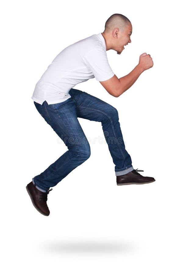 levitation Homem asiático novo atrativo engraçado que salta no passeio da dança do ar fotografia de stock royalty free