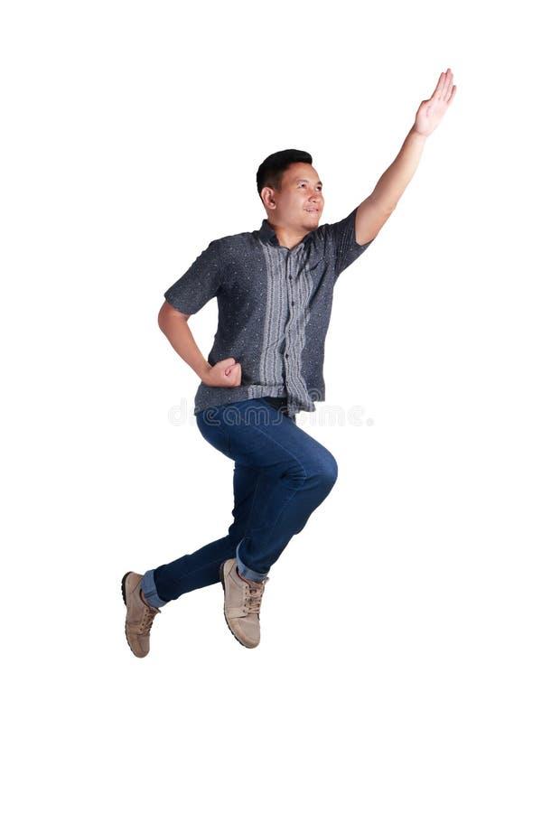 levitation Voo de aumentação do homem novo acima foto de stock