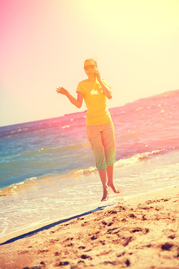 Young woman levitating on a beach royalty free stock photo