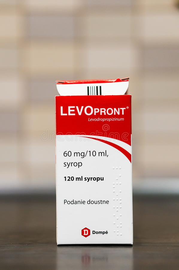 Levopront medicine in a box. Poznan, Poland - January 19, 2019: Dompe Levopront coughing syrup in a opened box on a wooden table royalty free stock photos