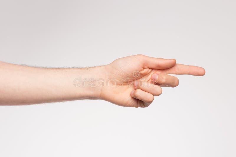 Lewej ręki wskazywać fotografia stock
