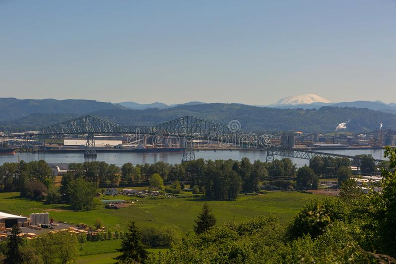 Lewis and Clark Bridge over Columbia River with Mt. St Helens. Lewis and Clark Cantilever Bridge over Columbia River between Rainier Oregon and Longview stock image