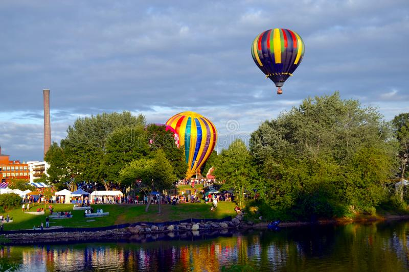 Vibrant Colorful Piloted Helium Hot Air Balloon In Flight