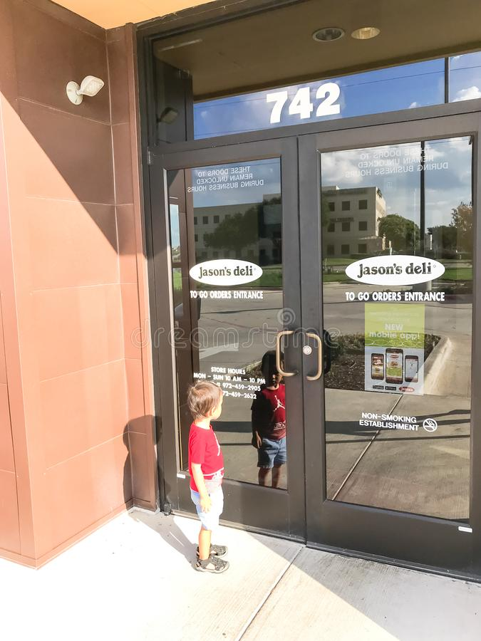Customer enter Jason Deli restaurant chain in Lewisville, Texas, USA. LEWISVILLE, TX, US-SEPT 13, 2018:Customer enter Jason Deli, family owned fast casual royalty free stock photography