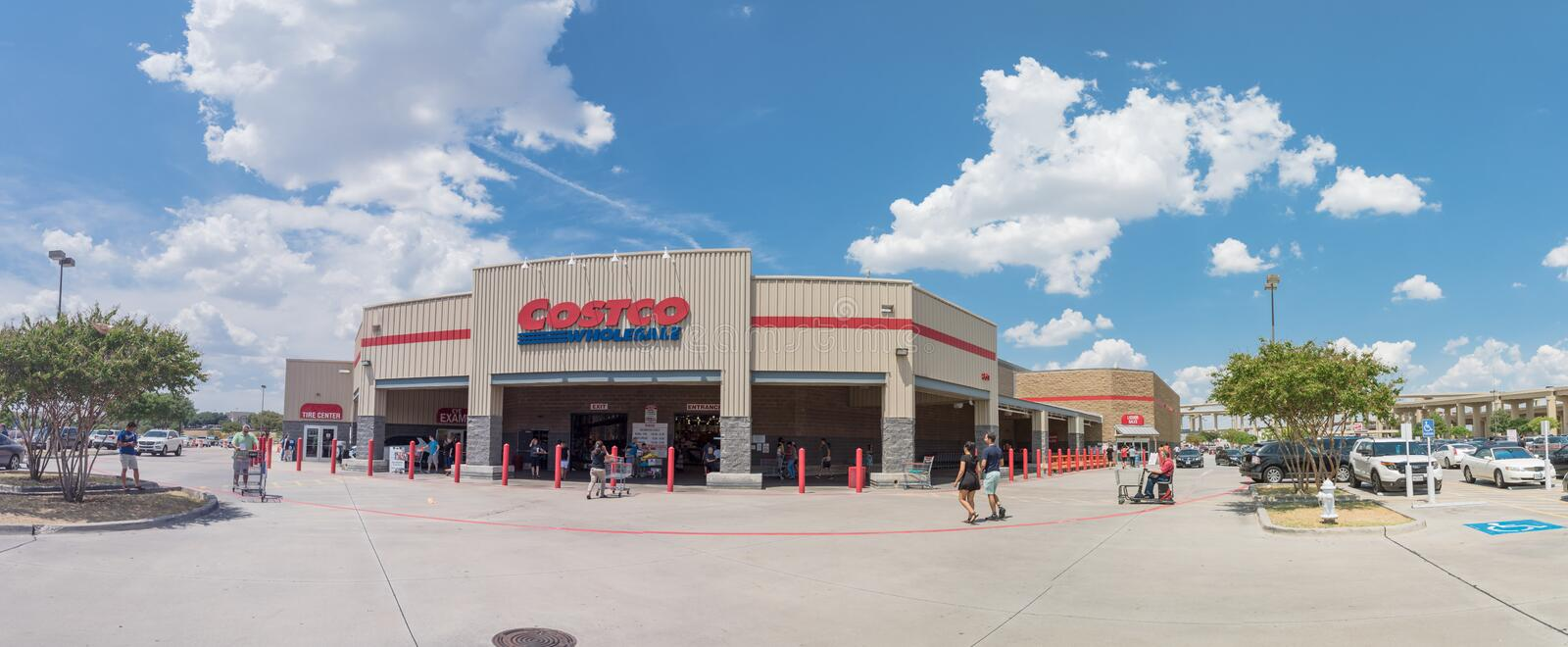 Panorama view entrance to Costco Wholesale store in Lewisville,. Lewisville, TX, USA-AUG 4, 2018:Panorama entrance Costco Wholesale storefront and liquor store royalty free stock photo