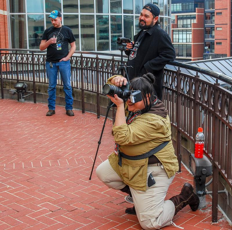 Lexington, Ky US - March 11, 2018 - Lexington Comic & Toy Con Photographers snap pictures of cosplayers as they pose. On the balcony of the convention center royalty free stock photography