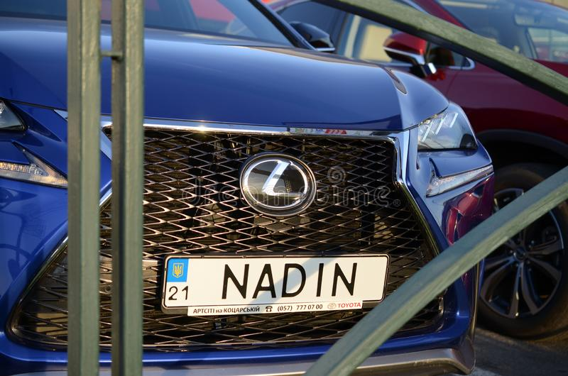 Lexus NX 300h front part with company logo and name NADIN on license plate number stock image