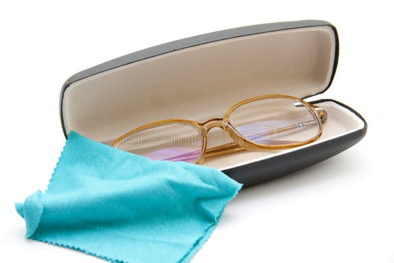Lezingsglazen in het geval en de doek stock afbeelding