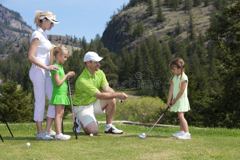 Lezione di golf della famiglia immagini stock libere da diritti