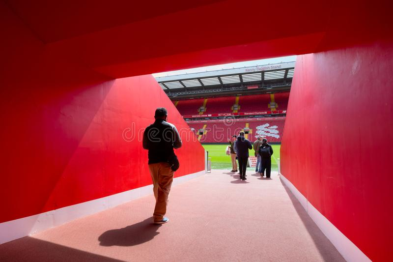 LFC staffs and a group of football fans in Anfield stadium, Liverpool, UK. LIVERPOOL, UNITED KINGDOM - MAY 17 2018: LFC staffs and a group of its football fans stock images