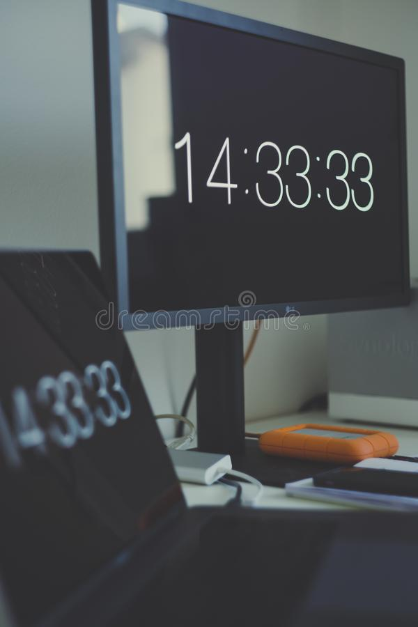 Lg Flat Screen Computer Monitor With 14:33:33 Display stock image