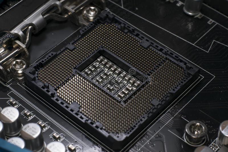 LGA 1155 socket. An intel LGA 1155 CPU socket stock photos
