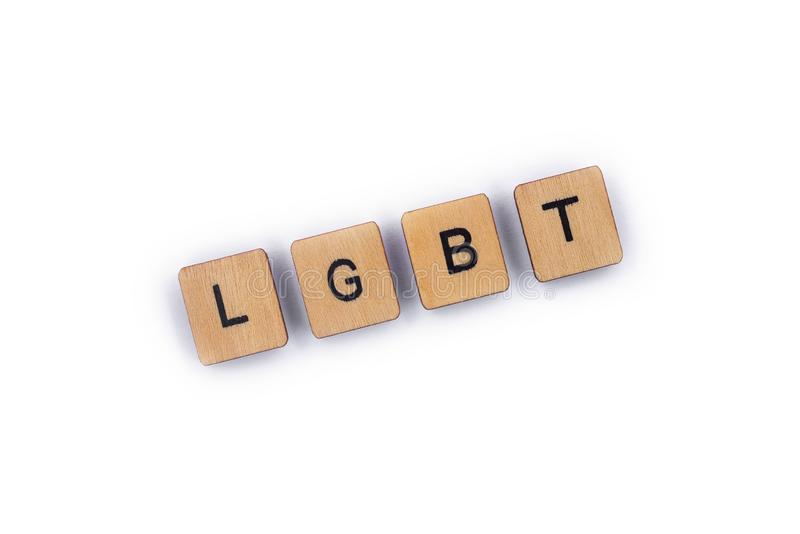 LGBT. The abbreviation LGBT - standing for lesbian, gay, bisexual, and transgender, spelt with wooden letter tiles over a plain white background royalty free stock photo