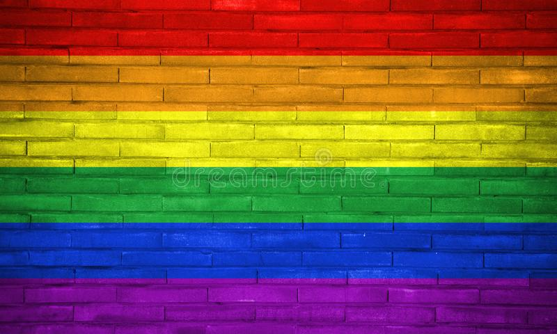 LGBT civil rights rainbow flag painted on bricks wall. Copy space for text or graphic. Concept for gay civil rights, same sex marriages, gender neutrality royalty free stock photo