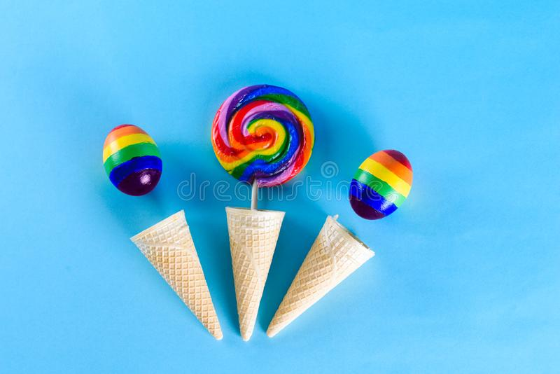 Lgbt family. Eggs with lgbt flag color and rainbow lollipop royalty free stock images