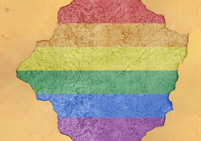 LGBT flag in big concrete cracked hole and broken material facade. Structure stock photography