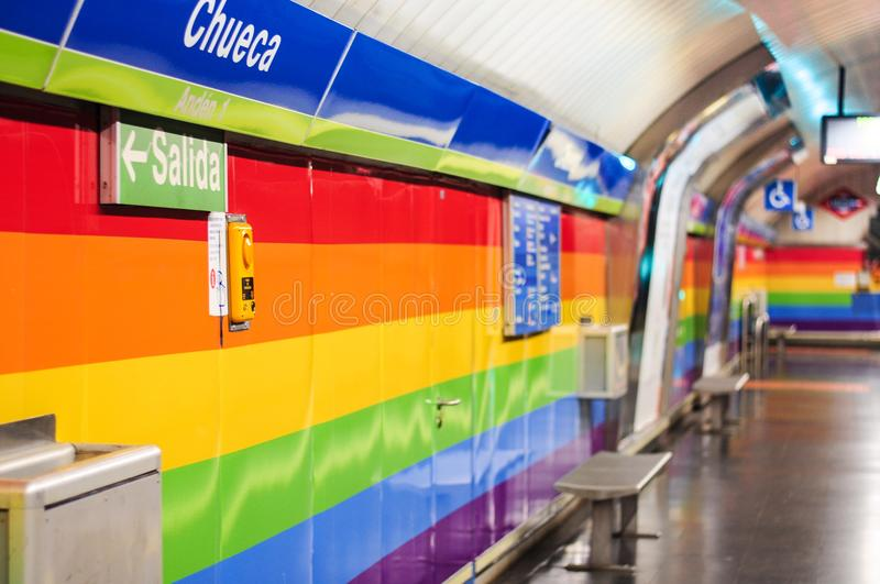 LGBT flag colours walls of the Metro station Chueca in gay district of Madrid, Spain. Made for World Pride 2017 stock photography