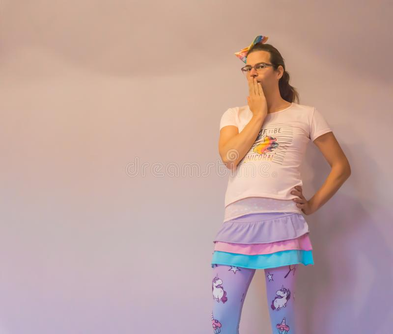 LGBT funny transgender girl in kawaii unicorn outfit making oh my expression stock images