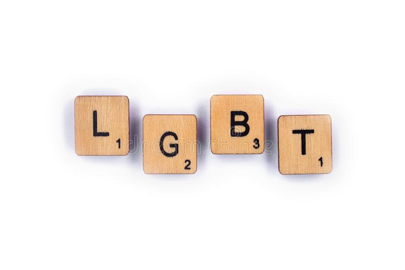 LGBT. London, UK - July 8th 2018: The abbreviation LGBT - standing for lesbian, gay, bisexual, and transgender, spelt with wooden letter tiles over a plain white stock photo