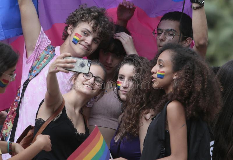 LGBT pride celebrations in mallorca people taking a selfie detail. People take a selfie during LGBT pride day celebrations in the street of palma de mallorca royalty free stock images