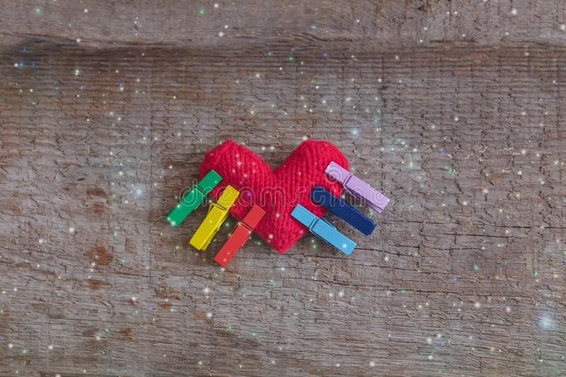 LGBT rainbow knitted heart symbol of love on wooden background, concept stock photos