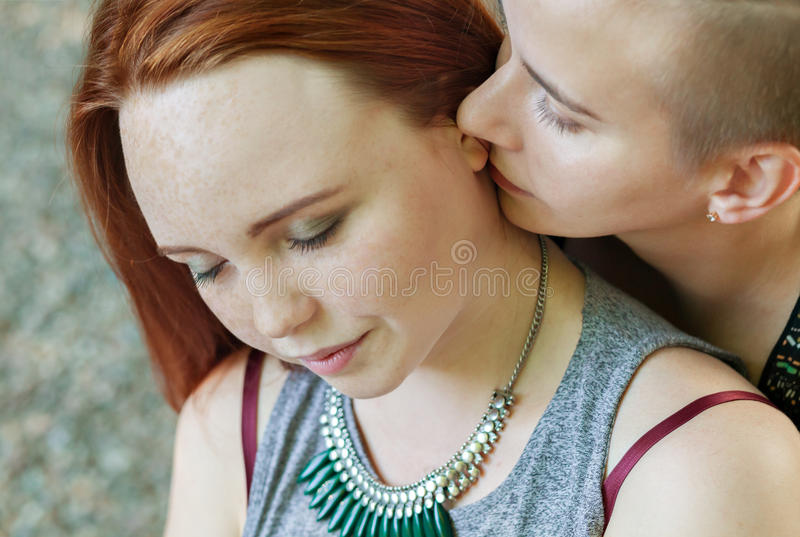 LGBT women. Young lesbian couple walking in the park together. Delicate relationship. The notion of same-sex marriage. Selective focus stock images