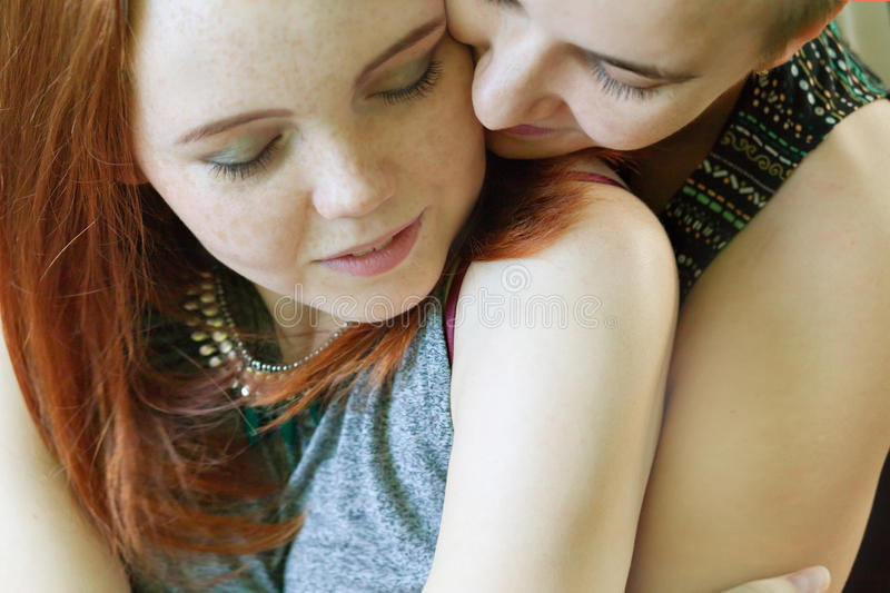 LGBT women. Young lesbian couple walking in the park together. Delicate relationship. The notion of same-sex marriage. Selective focus royalty free stock images