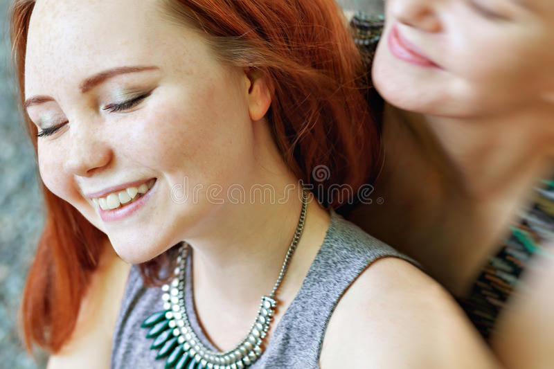LGBT women. Young lesbian couple walking in the park together. Delicate relationship. Selective focus. LGBT women. Young lesbian couple walking in the park royalty free stock photo