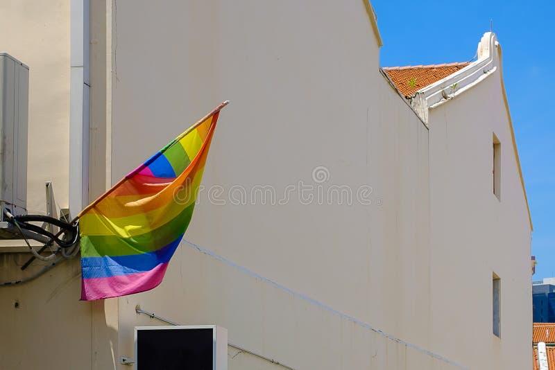 LGBTQ从一个房子的旗子飞行女同性恋,快乐,两性的,变性和奇怪社区 免版税库存照片