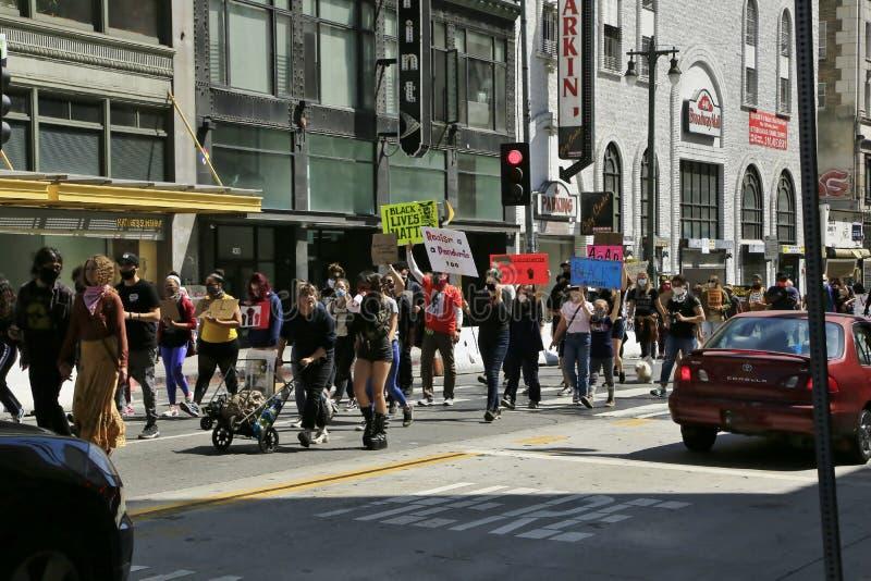 LGBTQ protestors marching in DTLA  royalty free stock photo
