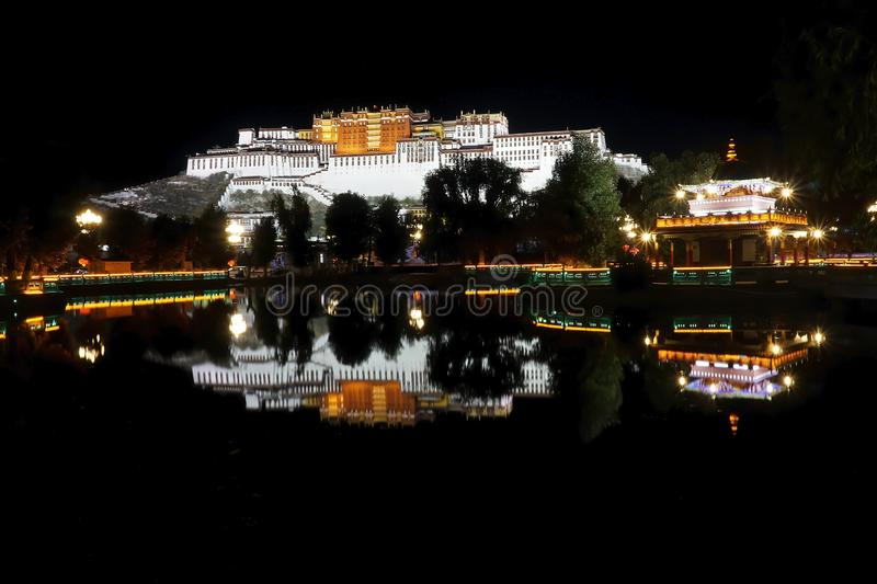 Lhasa ex Tibet now China, Chengguan District The Potala Palace, night view with reflection on the pond.  stock image