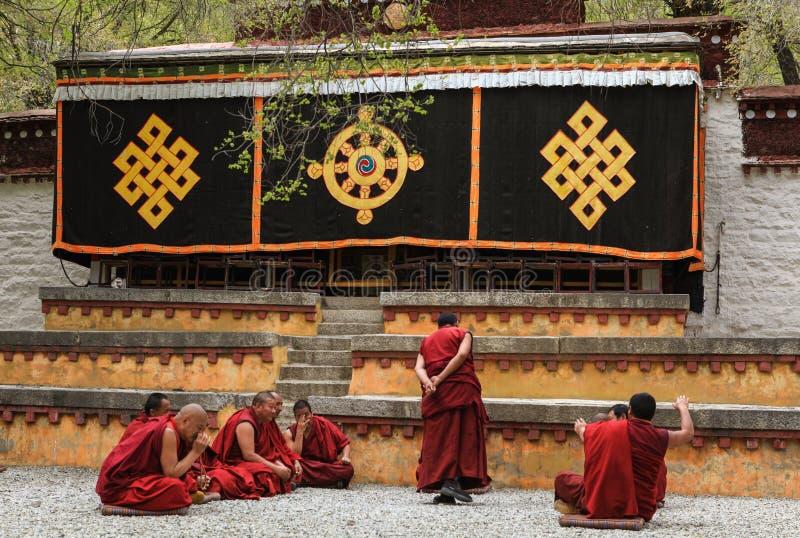 Dharma Debating at Sera monastery. Lhasa,Tibet-May 6,2014;The famous dharma debating,assembly of Lamas to discuss about tripitaka in courtyard at Sera monastery royalty free stock images