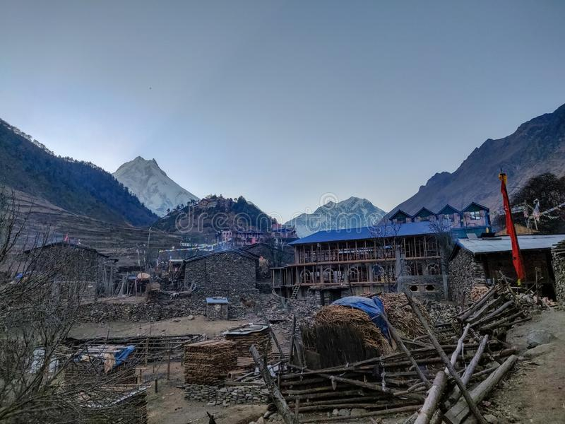 Lho village of Manaslu Conservation Area. In Nepal. Mount Manaslu on the left side is the 8th largest mountain in the world royalty free stock image