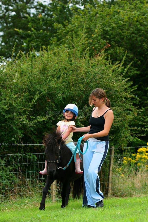 A lição de equitação foto de stock royalty free