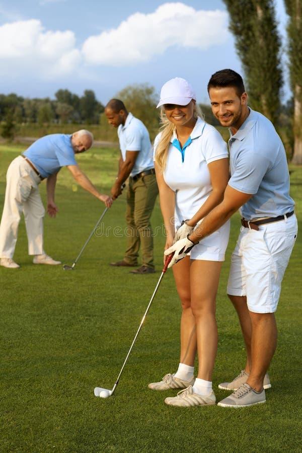 Lição de golfe foto de stock